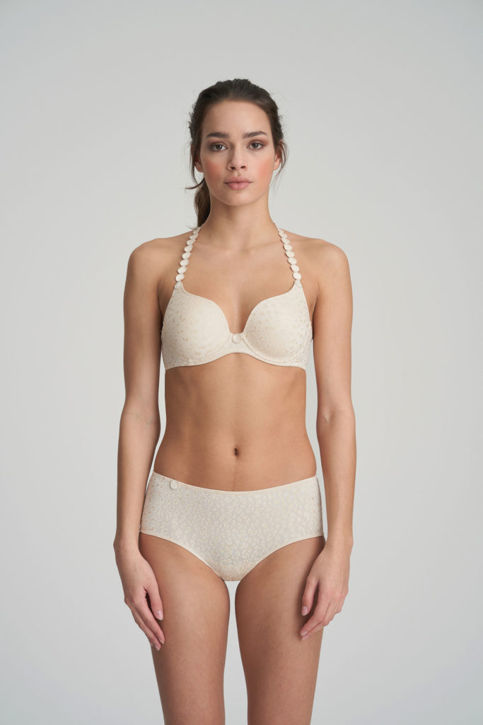 Woman wearing Marie Jo L'Aventure Tom Performed Plunge Bra in Pearled Ivory with matching briefs