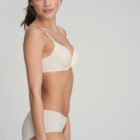 Side image of Woman wearing Marie Jo L'Aventure Tom G Rio Brief in Pearled Ivory with matching bra