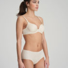 Woman wearing Marie Jo L'Aventure Tom G Rio Brief in Pearled Ivory With matching bra