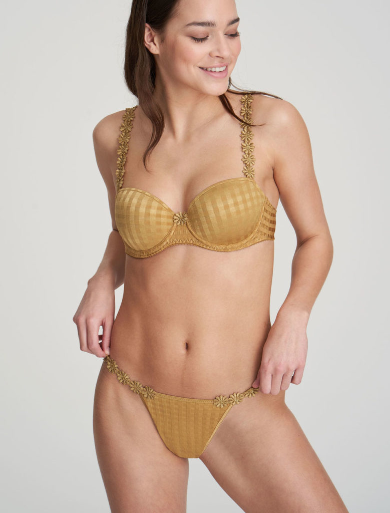Woman wearing Marie Jo Avero Gold Daisy Gstring with Matching Bra