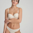Woman wearing Marie Jo L'Aventure Tom G String in Pearled Ivory With matching bra