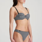 Side image of woman wearing Marie Jo L'Aventure Tom G-String in Black and White Check with matching bra