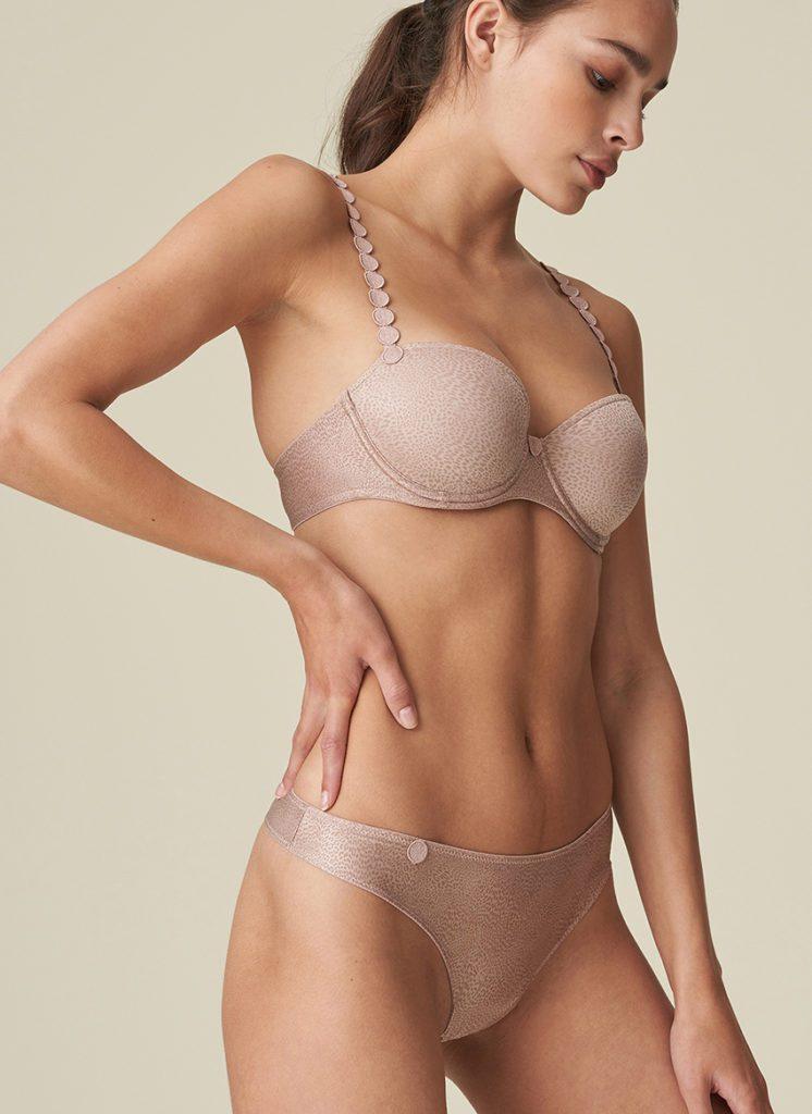 Women wearing Marie jo LAventure Tom Padded plunge bra in patina animal print with matching Gstring