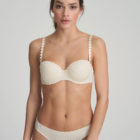 Woman wearing Marie Jo L'Aventure Tom Padded Balconnet Bra in Pearled Ivory with matching briefs