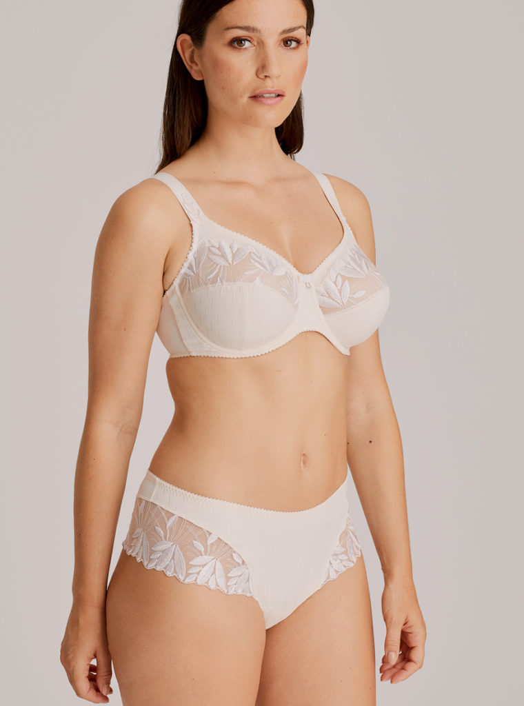 Woman wearing Prima Donna Orlando Comfort Bra In ivory with matching brief