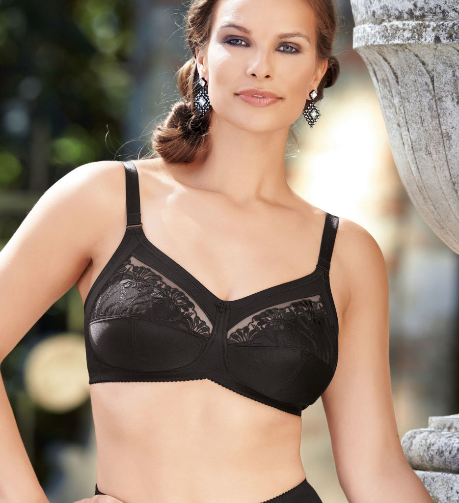 Woman wearing Anita Safina soft cup comfort bra in black