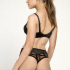 Back view of Women wearing Louisa Bracq Brazilian Shorty Brief in black with matching Bra