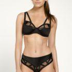 Women wearing Louisa Bracq Brazilian Shorty Brief in black with matching Bra