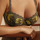 Woman wearing Close up image of Prima Donna Palace Garden Padded Balconnet Bra In Khaki Reptile