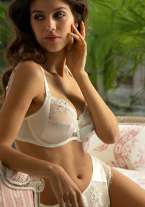 Model wears the refined and sexy Emotion Beaute white lace bra from Lise Charmel
